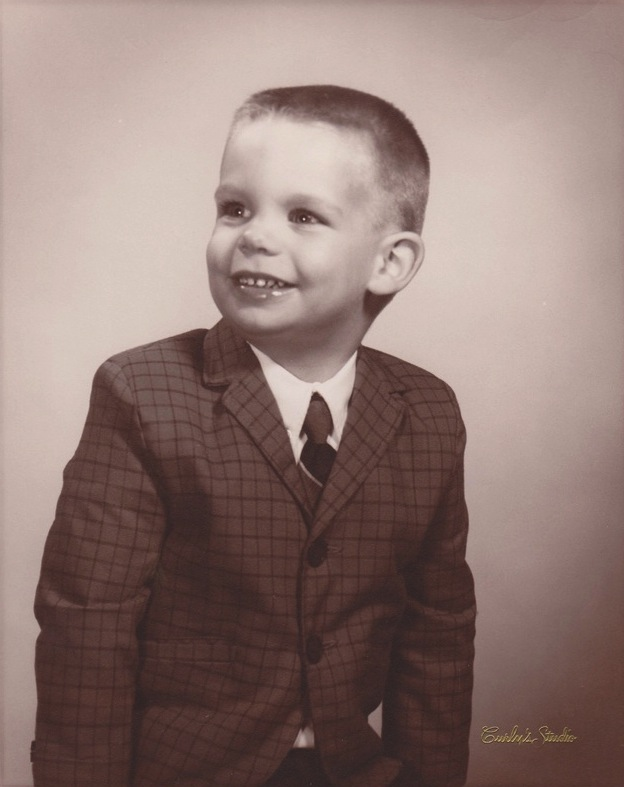 Brian Schappert as boy in suit