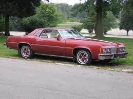 1977 maroon Pontiac Grand Prix